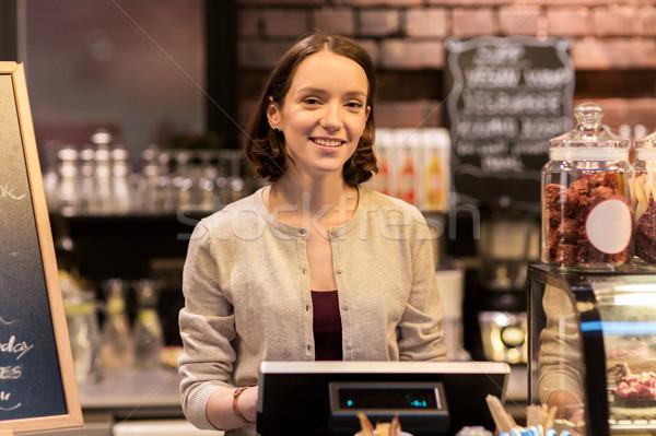 happy woman or barmaid with cashbox at cafe Stock photo © dolgachov