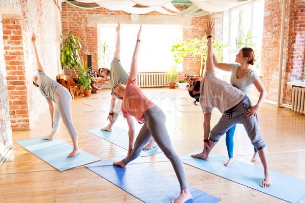 group of people doing yoga exercises at studio Stock photo © dolgachov