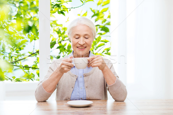 happy senior woman with cup of coffee Stock photo © dolgachov