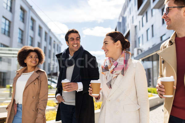 group of people or friends with coffee in city Stock photo © dolgachov