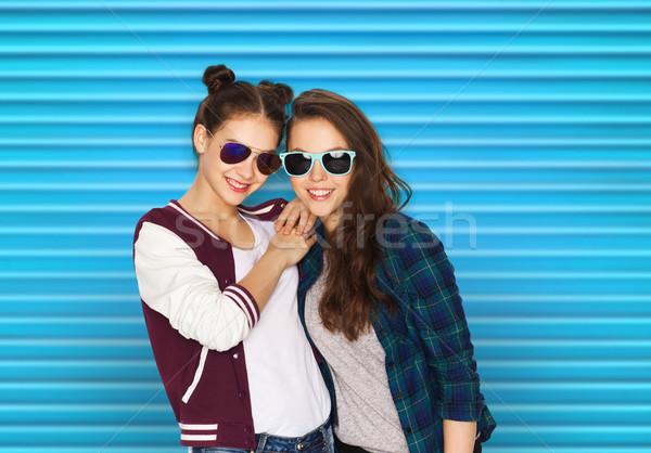 happy smiling pretty teenage girls in sunglasses Stock photo © dolgachov