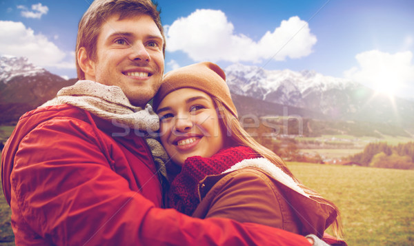 happy young couple hugging over alps mountains Stock photo © dolgachov