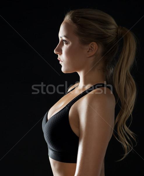 Fiatal nő fekete sportruha pózol tornaterem sport Stock fotó © dolgachov