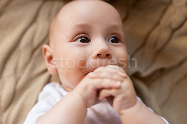 close up of sweet little baby boy lying on blanket Stock photo © dolgachov