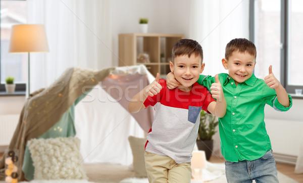 happy smiling little boys showing thumbs up Stock photo © dolgachov