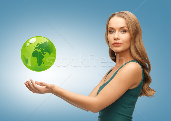 woman holding green globe on her hands Stock photo © dolgachov