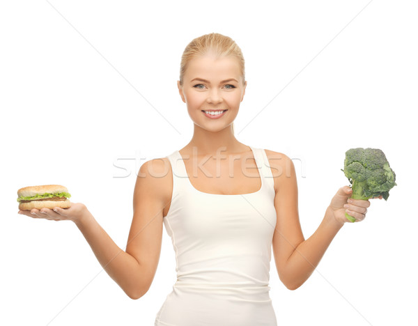 woman with broccoli and hamburger Stock photo © dolgachov