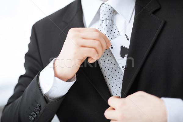 Mano nascondere ace giacca tasca Foto d'archivio © dolgachov