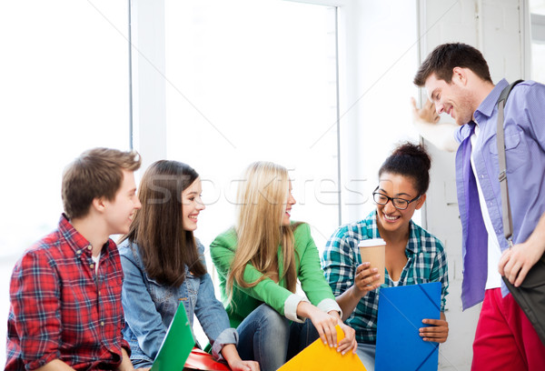 students communicating and laughing at school Stock photo © dolgachov