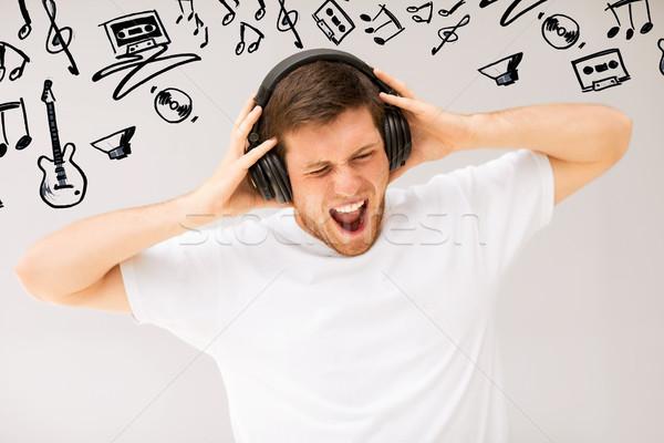 Człowiek słuchawki słuchania głośno muzyki technologii Zdjęcia stock © dolgachov
