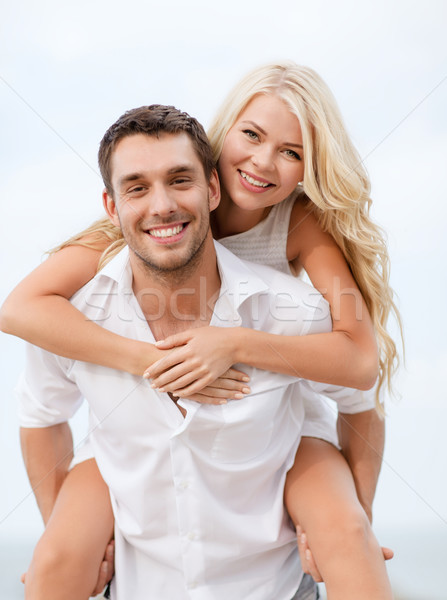 couple having fun on the beach Stock photo © dolgachov