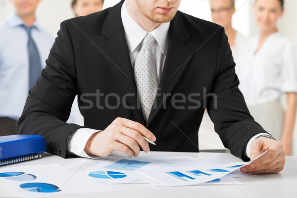 businessman working with papers Stock photo © dolgachov