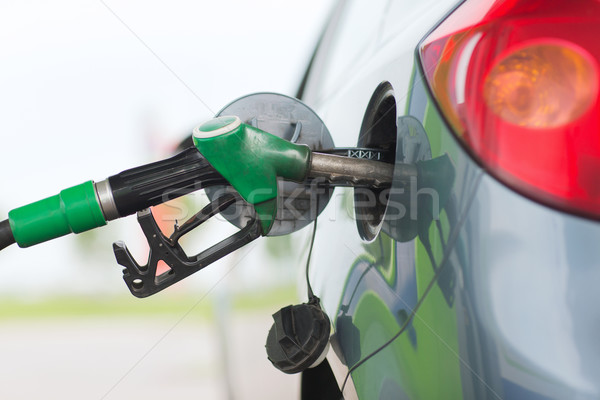 pumping gasoline fuel in car at gas station Stock photo © dolgachov
