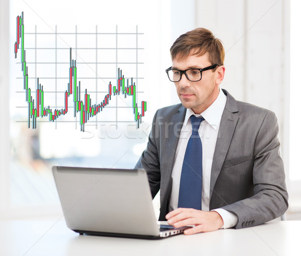 businessman with laptop computer and forex chart Stock photo © dolgachov
