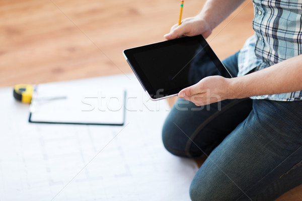 male with tablet pc, blueprint and measuring tape Stock photo © dolgachov
