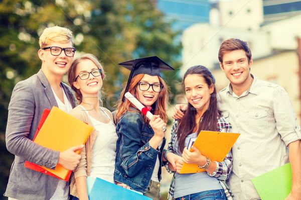 Diákok tinédzserek akták diploma oktatás kampusz Stock fotó © dolgachov