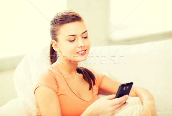 woman with smartphone at home Stock photo © dolgachov