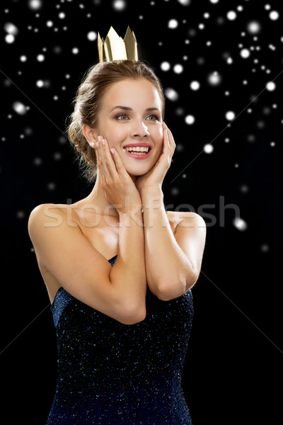 smiling woman in evening dress wearing crown Stock photo © dolgachov