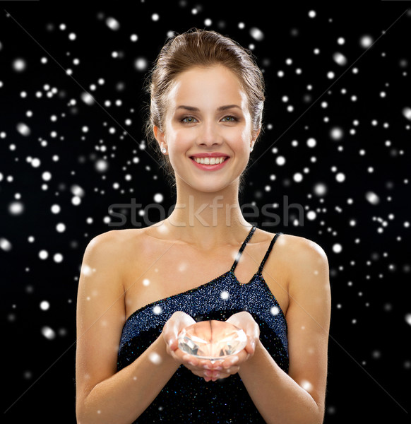 smiling woman with diamond Stock photo © dolgachov