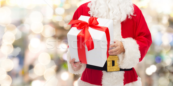close up of santa claus with gift box Stock photo © dolgachov