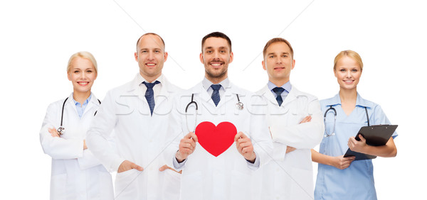 group of smiling doctors with red heart shape Stock photo © dolgachov