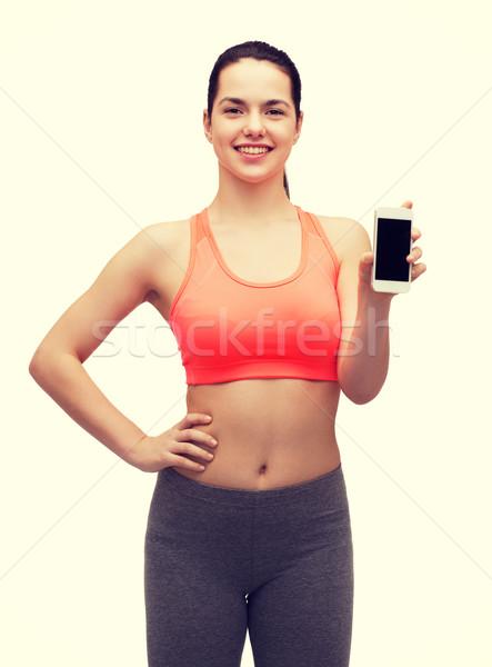 sporty woman with smartphone Stock photo © dolgachov