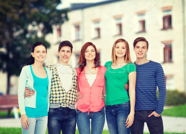 Csoport mosolyog diákok áll oktatás emberek Stock fotó © dolgachov