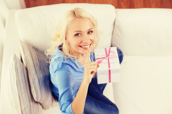 smiling woman with gift box at home Stock photo © dolgachov