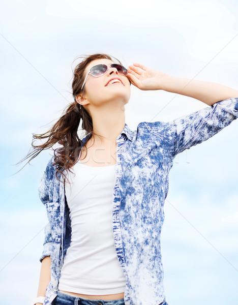 teenage girl in shades outside Stock photo © dolgachov