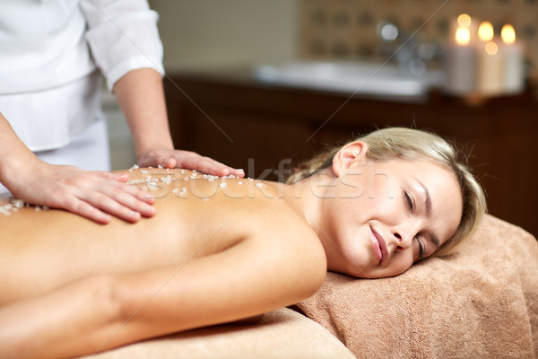 Stock photo: close up of woman lying and having massage in spa