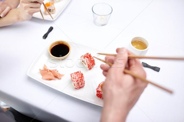 Közelkép pár eszik szusi étterem éttermi étel Stock fotó © dolgachov
