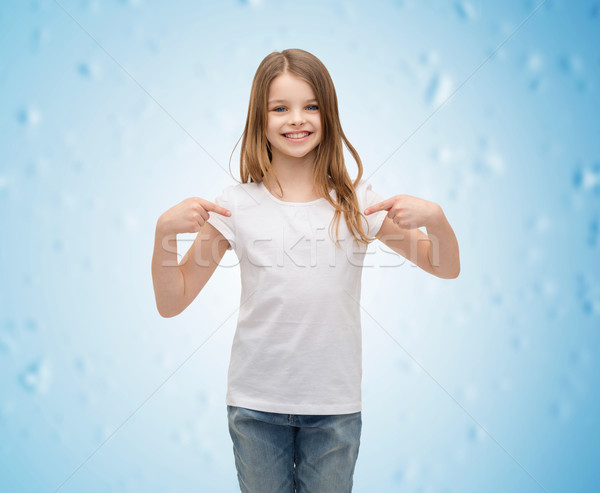 smiling little girl in blank white t-shirt Stock photo © dolgachov