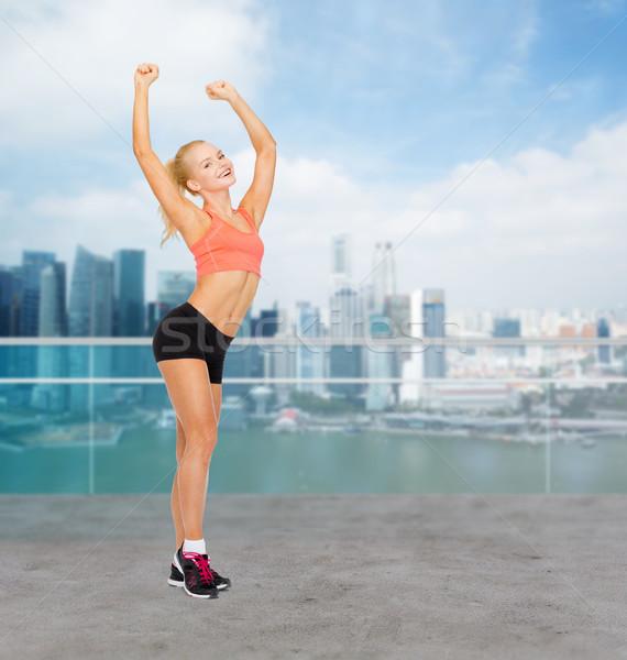 happy beautiful sporty woman dancing Stock photo © dolgachov