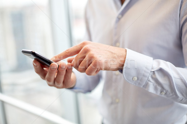 close up of man hands with smartphone at office Stock photo © dolgachov