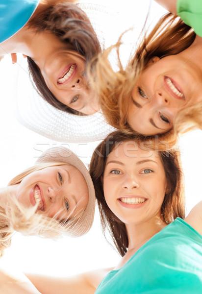 Twarze dziewcząt patrząc w dół uśmiechnięty lata wakacje Zdjęcia stock © dolgachov