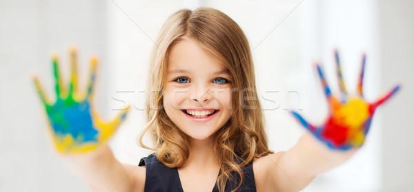 Fille peint mains éducation école Photo stock © dolgachov