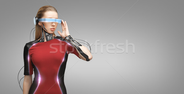 woman with futuristic glasses and sensors Stock photo © dolgachov