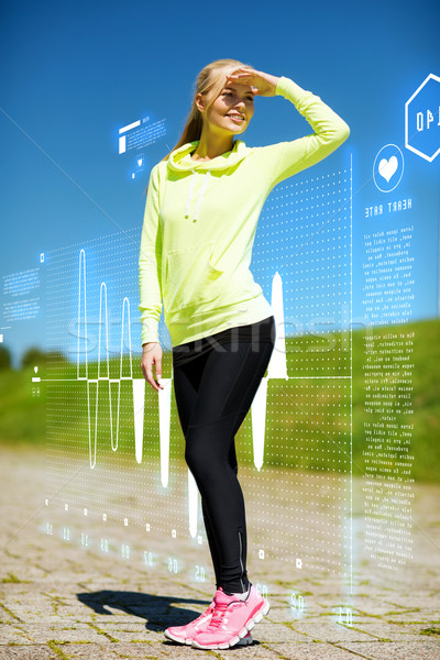 woman doing sports outdoors Stock photo © dolgachov