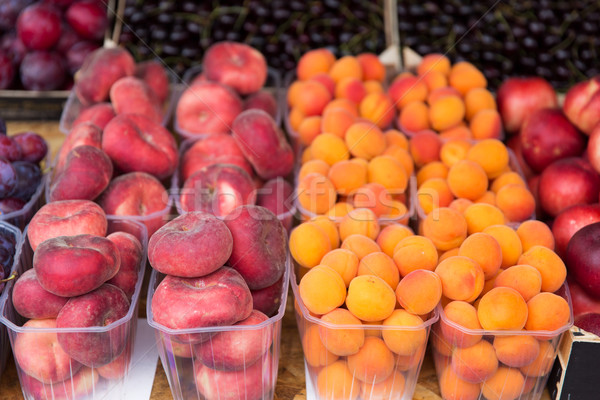 close up of peaches and apricots at street market Stock photo © dolgachov