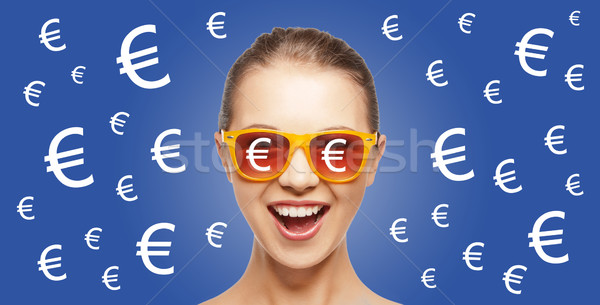 happy woman in shades with euro currency sings Stock photo © dolgachov