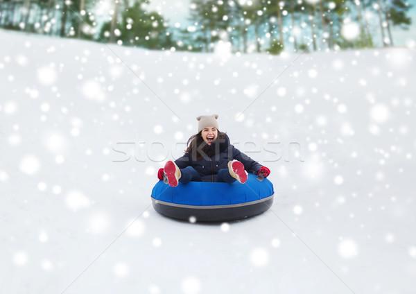 Heureux adolescente vers le bas neige tube hiver Photo stock © dolgachov