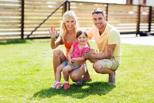 happy family hugging outdoors Stock photo © dolgachov