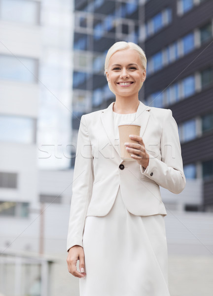 smiling businesswoman with paper cup outdoors Stock photo © dolgachov