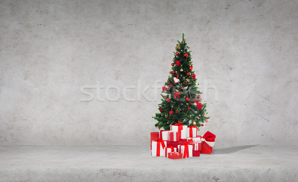 christmas tree with gifts over concrete wall Stock photo © dolgachov