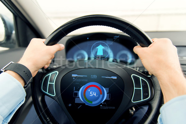 close up of man driving car with volume level icon Stock photo © dolgachov
