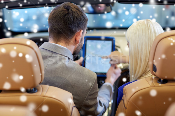 couple sitting in cabrio car with tablet pc Stock photo © dolgachov