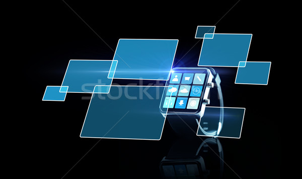 close up of smartwatch with app icons and screens Stock photo © dolgachov