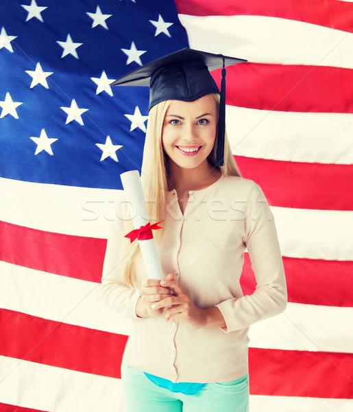 Studente laurea cap certificato felice bandiera americana Foto d'archivio © dolgachov