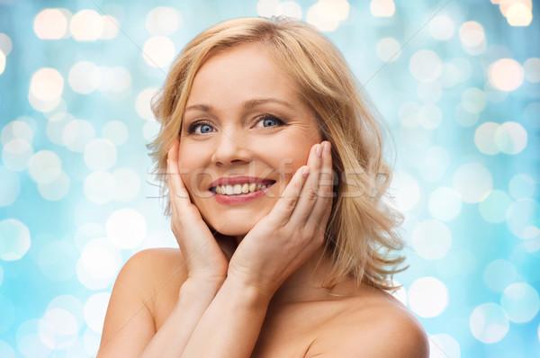 Mosolygó nő meztelen vállak megérint arc szépség Stock fotó © dolgachov