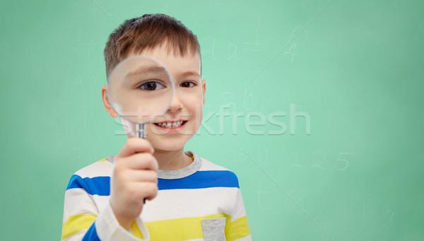счастливым мало мальчика глядя увеличительное стекло детство Сток-фото © dolgachov